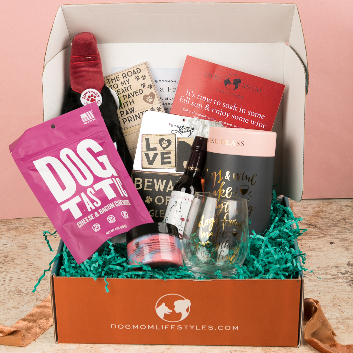 open box with dog treats and toys